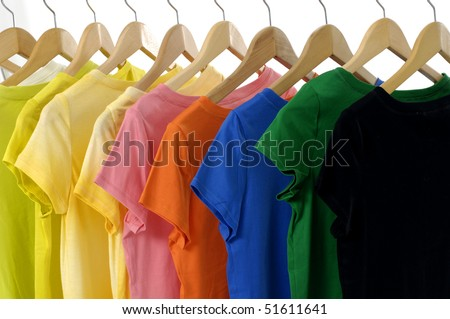 bright colored Tee Shirts hanging - stock photo