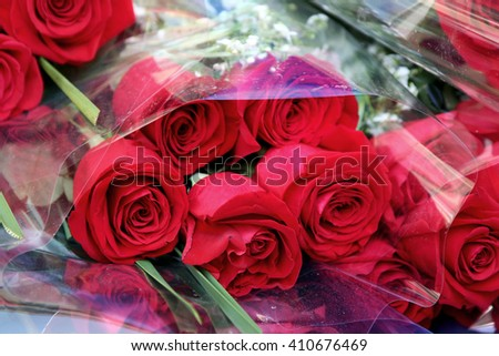 Bright colorful bouquet of flowers in beautiful cellophane packaging. Festive bouquet of flowers. Give a bouquet of flowers. - stock photo