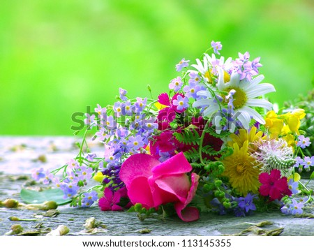 Bright colorful bouquet of garden and wild natural flowers - stock photo