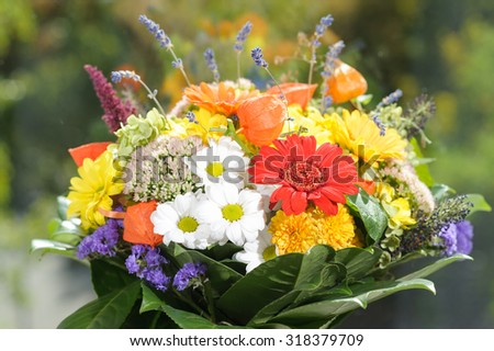 Bright colorful bouquet of garden and wild natural flowers, selective focus - stock photo