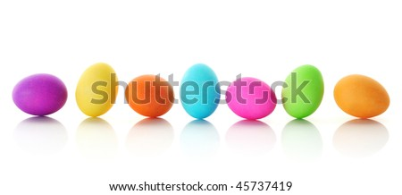 Bright, colorful Easter eggs in row, isolated on white - stock photo