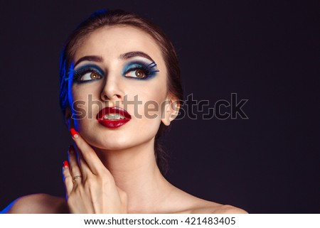 Bright colorful makeup beautiful young woman. The concept of a woman's beauty.fashion portrait - stock photo