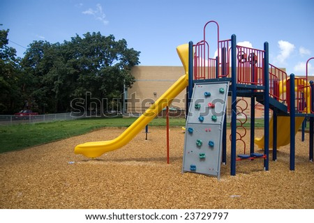 Bright colorful playground at a school yard - stock photo