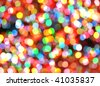 Bright, colorful, rainbow lights are blurred and shiny. Makes a good Christmas celebration or Nightclub background for festivals. - stock photo