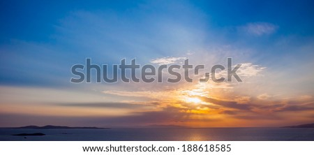 Bright colorful sunset on the sea with beautiful clouds - stock photo