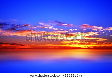 bright, colorful sunset over the sea, blue sky, rich cloud - stock photo