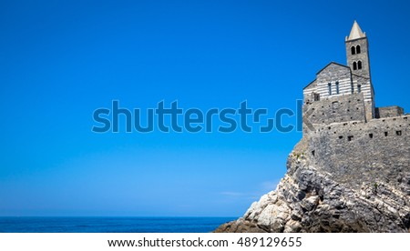 Bright colors in this panorama from the sea of San Pietro Church in Porto Venere, Italy
