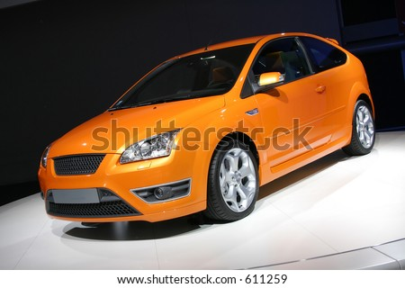 bright coloured european hatchback car - stock photo