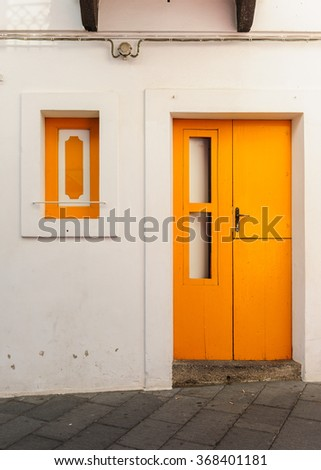 Bright coloured old door and window of a typical house on Stromboli island, Sicily, Italy. - stock photo