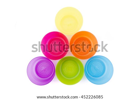 Bright colourful plastic kitchenware isolated on white
