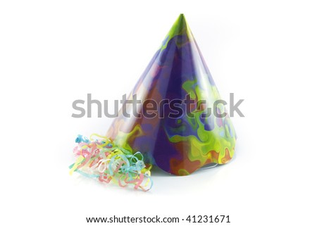 Bright cone shaped party hat with party streamers on a reflective white background - stock photo