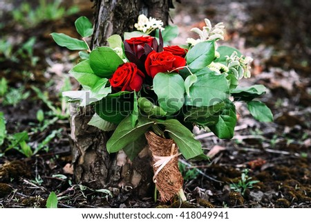 bright contrast bouquet with rose and fresh leaves - stock photo
