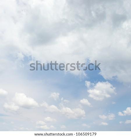 bright cumulus clouds and blue sky - stock photo