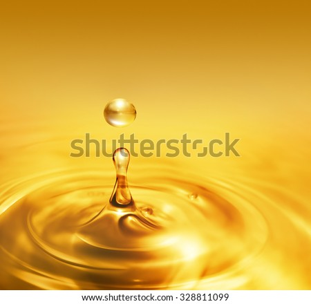 bright dripping oil close up as background - stock photo