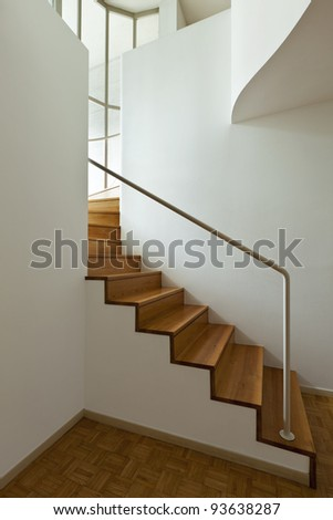 Bright duplex with hardwood floors,wooden stair - stock photo