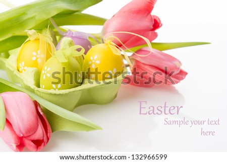 Bright easter eggs  and tulips on white background - stock photo