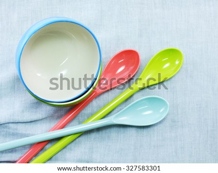 bright empty bowls Ceramic cups and plastic spoons - stock photo