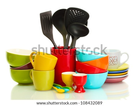bright empty bowls, cups and kitchen utensils isolated on white