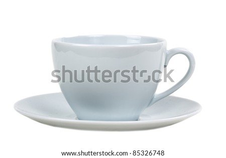 Bright empty cup and saucer isolated on white background - stock photo