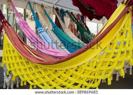 Bright ethnic hammocks with various pattern hanging in street market.