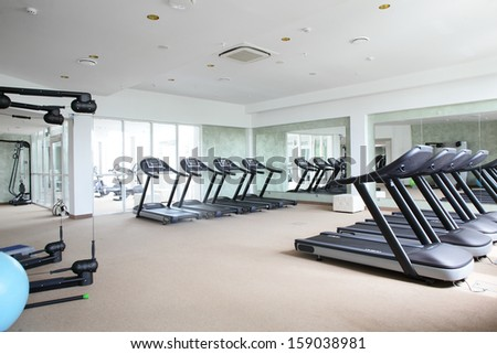 bright european gym with a lot of windows - stock photo