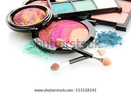 bright eye shadows and rouge with brushes, isolated on white