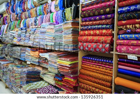Bright fabric for sale in Mutrah Souk, in Mutrah, Muscat, Oman, Middle East - stock photo