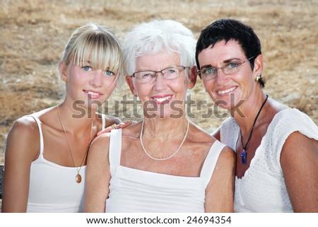 bright family lifestyle portrait of three generations of women - stock photo