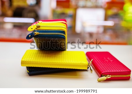 Bright fashion wallet in store - stock photo