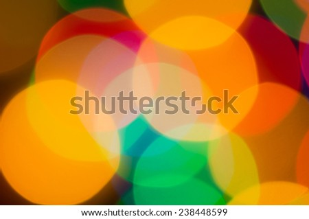 Bright festive background with colorful round lights.Festive illuminations de focused