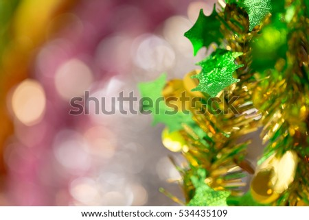 bright festive christmas or new year decorative tinsel glitter glowing and shine background with selective focus.