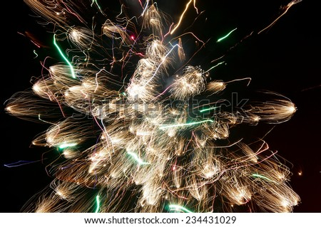 Bright firework explosion in the night sky  - stock photo