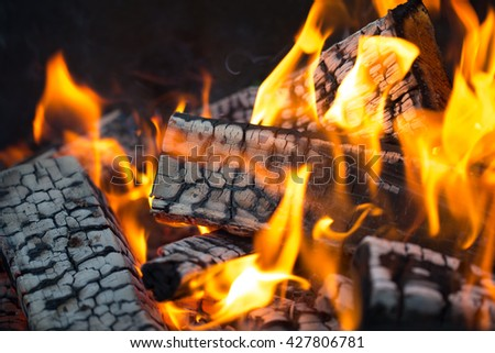 Bright flame of bonfire. Defocused. - stock photo