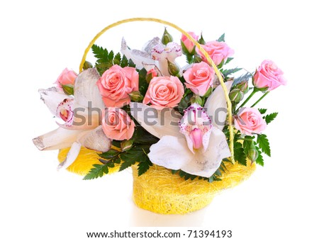 Bright flower bouquet in basket isolated on white - stock photo