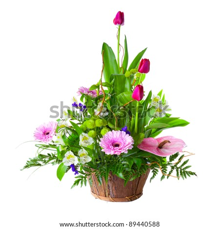 Bright flower bouquet in basket isolated over white background - stock photo