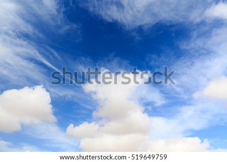 Bright fluffy clouds at dark blue sky