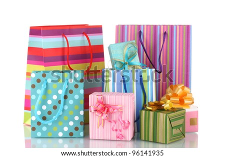 bright gift bags and gifts isolated on white - stock photo