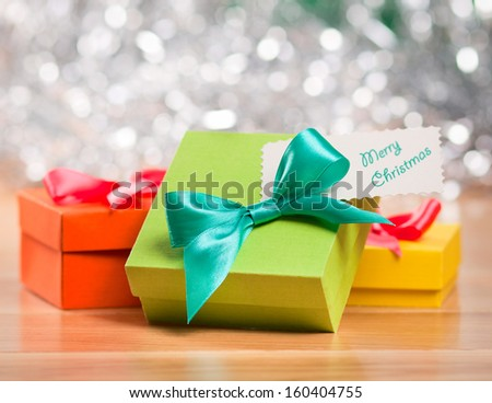 Bright gift boxes against silver background - stock photo