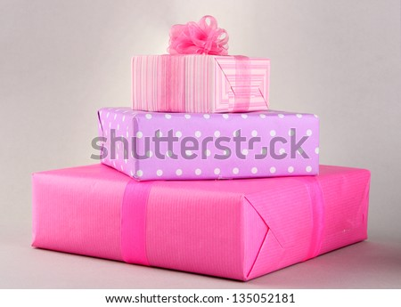 Bright gifts with bows on grey background - stock photo