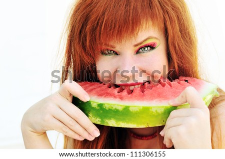 bright ginger girl with fresh watermelon