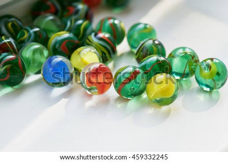 Bright glass multicolored stones round .