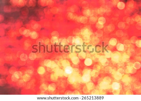 Bright glowing red abstract background in the form of bokeh - stock photo