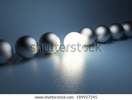 bright glowing sphere in a row. Leadership concept 3D illustration. - stock photo