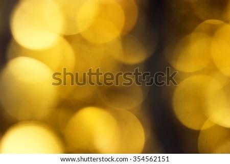 Bright gold lights defocused Christmas wallpaper. - stock photo