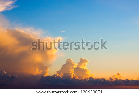 Bright golden clouds on the sunset sky - stock photo