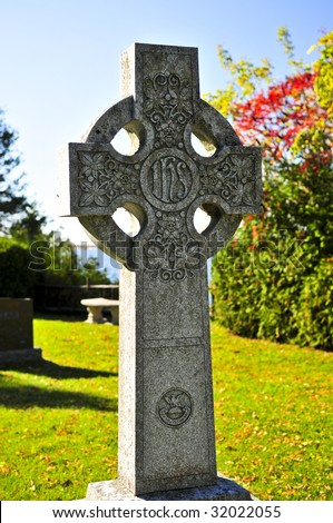 Bright graveyard lawn with ancient celtic crosses - stock photo