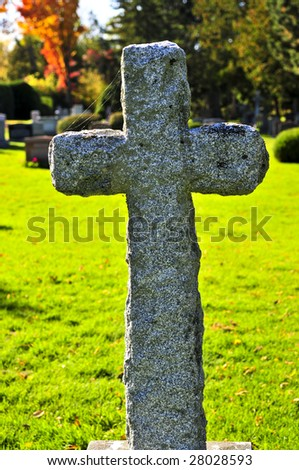 Bright graveyard lawn with ancient tombstone crosses - stock photo