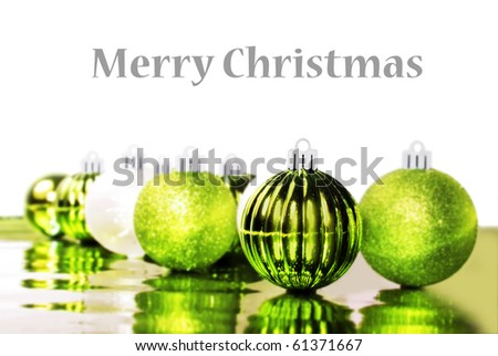 Bright green christmas decorations on a white background with space for text