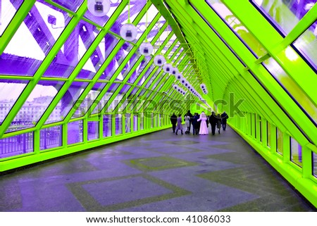 bright green corridor, people moving - stock photo