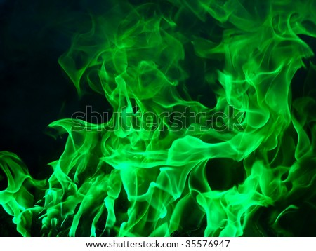Bright green flame on a black background - stock photo